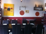 Cozy bistro with paintings of black sheep