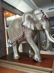 Regal Siamese White Elephant with shawl of weaved white jasmine buds