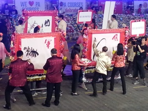 Chinese painting masters performing on site